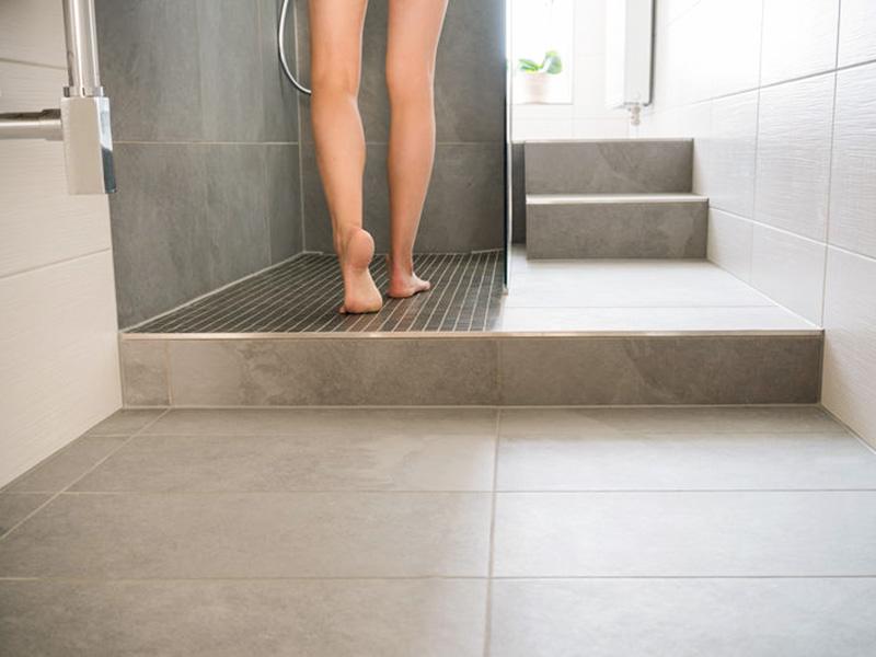 woman walking barefoot on warm tiles with under floor heating